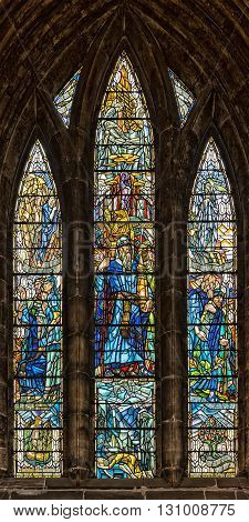 GLASGOW SCOTLAND APRIL 02 2016: One of the many beautiful stained glass windows that adorn the Glasgow cathedral in Scotland.