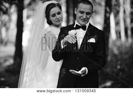 Groom Holding Weddind Rings And Then Throws Them. Wedding Rings On Air, Stop Frame