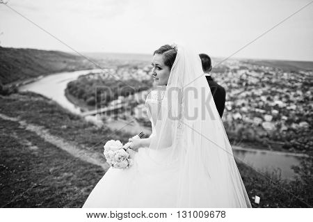 View Of Back Gorgeous Bride Walking With Groom, B&w Photo