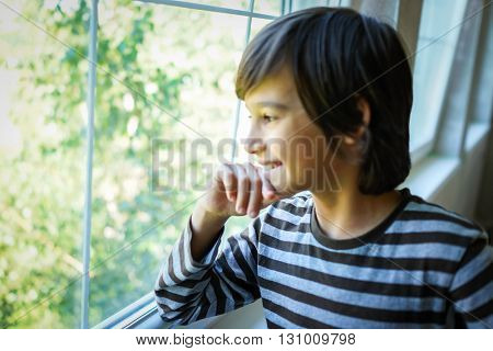 Kid at home opening window
