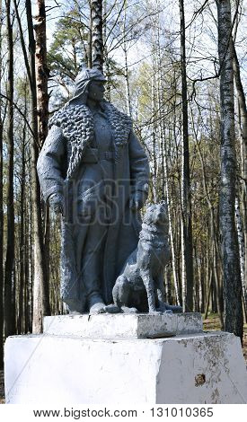 KRASNOGORSK, RUSSIA - APRIL 30, 2016: Monument to the Red Army border guard with a service dog in a public park in Krasnogorsk