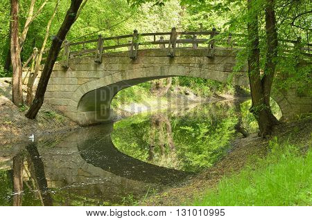 Russia.Saint-Petersburg.Ekateringofsky Park.Old wooden bridge in the Park.