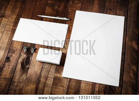 Photo of blank stationery set on vintage wooden table background. Mockup for branding identity. Blank branding identity set. Identity template. For designers portfolios.