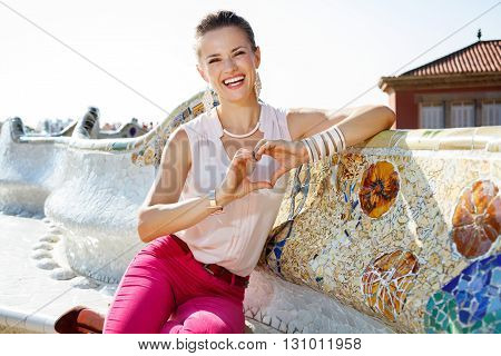 Happy Woman On Famous Trencadis Style Showing Heart Shaped Hands