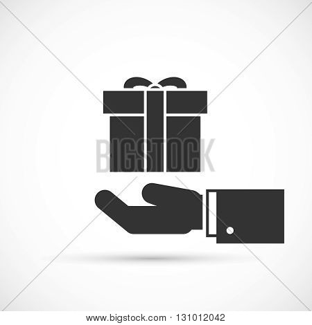 Gift box in hand icon. Male hand holding gift with ribbon