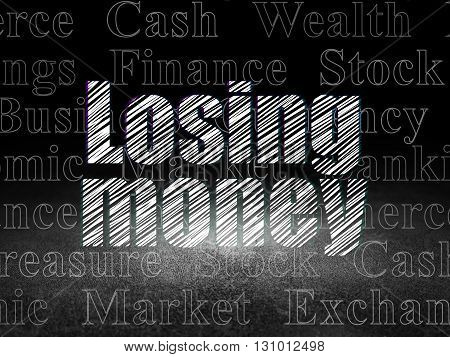 Money concept: Glowing text Losing Money in grunge dark room with Dirty Floor, black background with  Tag Cloud