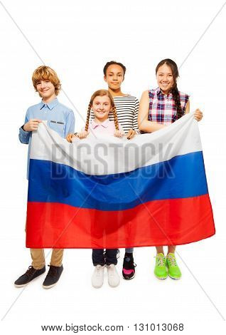 Group of four happy multiethnic teenage kids standing behind Russian flag, isolated on white