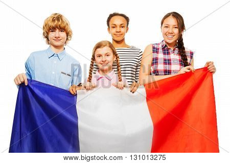 Four happy multiethnic students standing behind French flag, isolated on white background