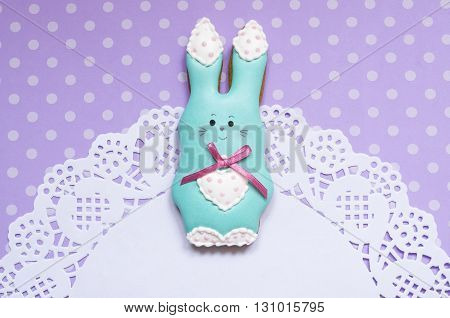 A cute polka dot background with a handmade honey-cake rabbit  and a place for your text for a baby shower party, a birthday party, an Easter party or other events.