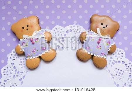 A cute polka dot background with handmade honey-cake bears and a beautiful napkin with a place for your text for a baby shower party, a birthday party or other events.