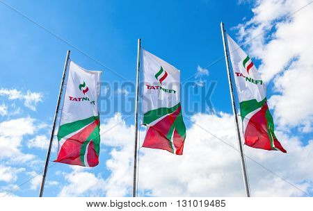 SAMARA RUSSIA - MAY 22 2016: The flags of oil company Tatneft against the blue sky. Tatneft is one of the russian oil companies