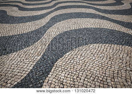 Lisbon pavement waves Handmade pavement in Lisbon Portugal.