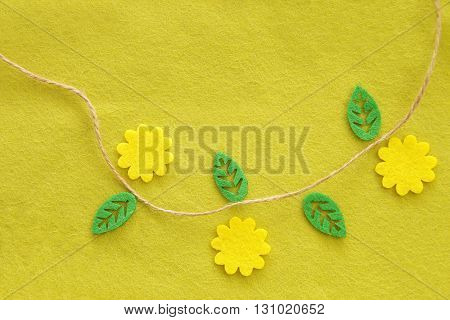 Yellow-green textile background with a flower and leaves