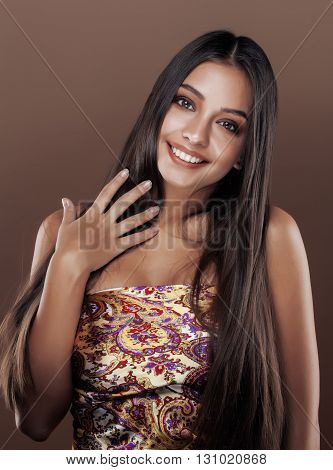 cute happy young indian woman in studio close up smiling gesturing, fashion beauty