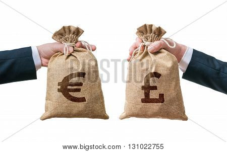 Currency Exchange Concept. Hands Holds Bags Full Of Money - Brit