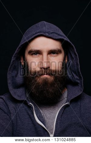 Handsome Male Beard In Hoodies, Studio Shot Black Background