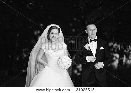 B&w Portrait Of Style Wedding Couple On Park