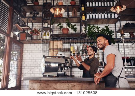 Coffee Shop Workers Standing At The Counter