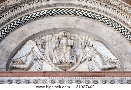 LUCCA, ITALY - JUNE 06, 2015: The central portal of the Cathedral of St Martin in Lucca. Lunette depicts the Redeemer in a mandorla held by two angels, Lucca, Italy, on June 06, 2015