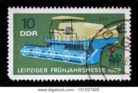 ZAGREB, CROATIA - JULY 02: a stamp printed in GDR shows Combine, Agricultural Machine, Leipzig Fair, circa 1969, on July 02, 2014, Zagreb, Croatia