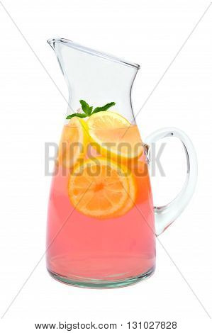 Pitcher Of Pink Lemonade With Lemon Slices And Mint Isolated On White