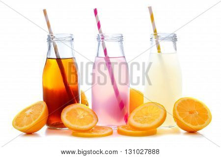 Iced Tea, Pink Lemonade And Lemonade Summer Drinks In Bottles With Straws And Lemon Slices Isolated