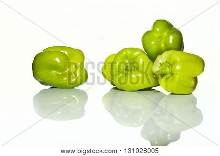 Green Peppers On A White