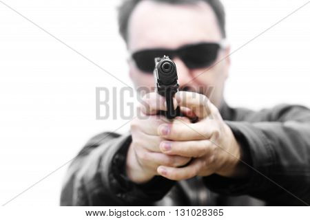 Men with gun on a white background