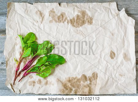Three small beetroots on crumpled craft paper. Copy space for you design. Top view.