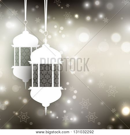 Decorative Ramadan background with lanterns on bokeh lights background