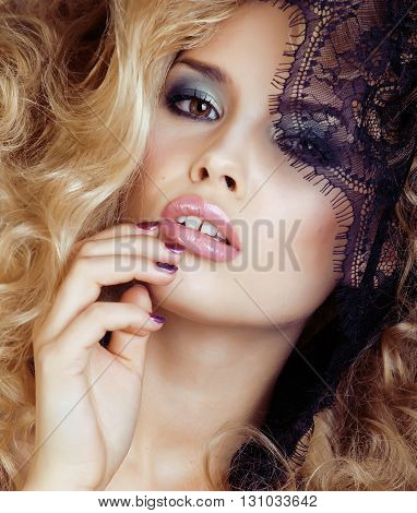 Portrait of beauty blond young woman through black lace close up sensual seduction, sexy people concept