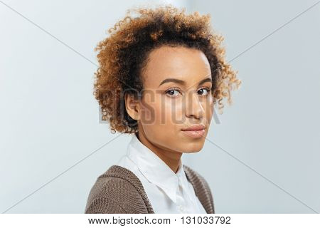 Closeup of beautiful african american young businesswoman with curly hair over white background