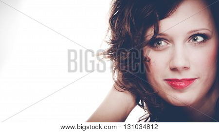 Skincare and cosmetics. Fashionable young woman with make up red lips and long dark hair.