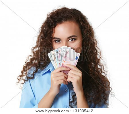 Beautiful young girl holding cash, isolated on white