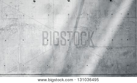 Horizontal Photo Blank Grungy Smooth Bare Concrete Wall with  Sunrays Reflecting on Surface. Empty Abstract background. Blue sky with clouds. Black and White