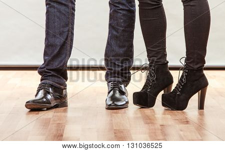 Legs of woman and man. Closeup feet in footwear shoes indoor