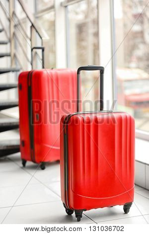 Red suitcases indoors