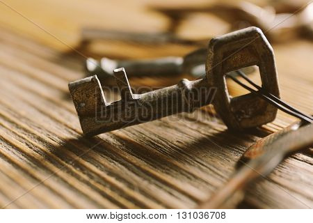 Bunch of old keys on wooden background