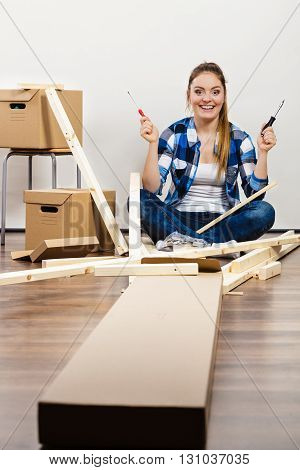 Woman Sitting On The Floor With Screwdrivers