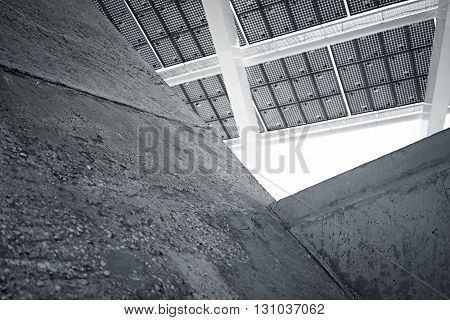 Horizontal Photo Modern Solar Panel with Blank Dark Concrete Blocks. Contemporary Building Architecture. Empty Abstract background