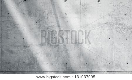 Horizontal Photo Blank Grungy Smooth Bare Concrete Wall with Sunrays Reflecting on Light Surface. Soft shadows. Empty Abstract background. Black and White.