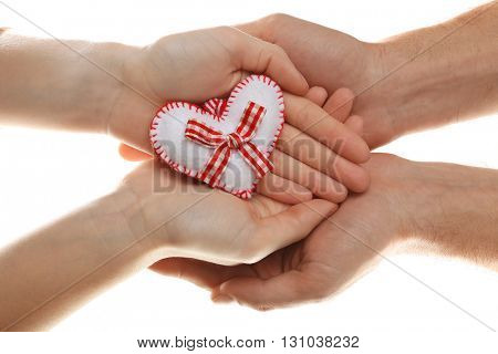 Decorative heart in female and male hands, isolated on white
