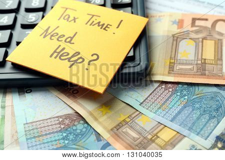Money concept. Black calculator with cash and documents, close up