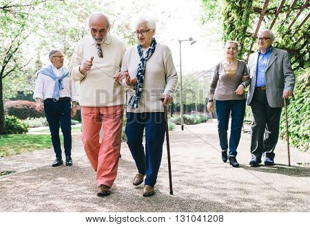 Group of old people walking outdoor. happy group of old mates