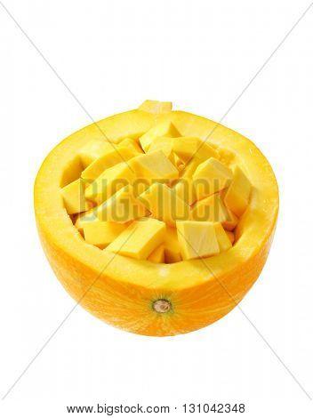 pumpkin pieces in scraped pumpkin half