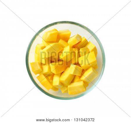 diced yellow pumpkin in a glass bowl