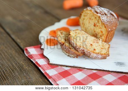 Carrot muffin on a white board