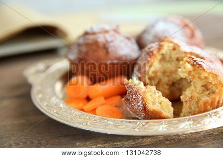Carrot muffins  on a golden plate