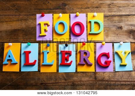 Sign FOOD ALLERGY on wooden background