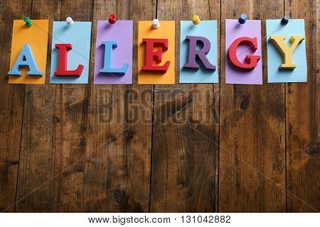 Word ALLERGY on wooden background